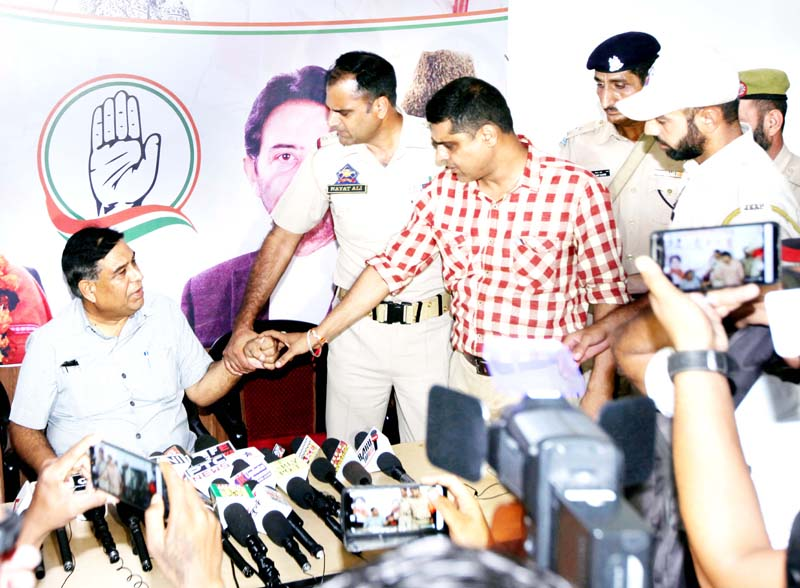 PCC chief spokesperson Ravinder Sharma being dragged out by cops during press conference at Cong office in Jammu on Friday. -Excelsior/Rakesh