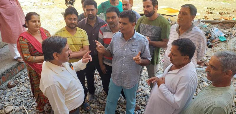 BJP spokesperson, Ashwani Kumar Chrungoo interacting with people at Sheikhpura Budgam.