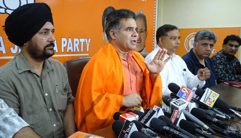 BJP state president Ravinder Raina and other party leaders at a press conference at Jammu on Saturday. —Excelsior/Rakesh