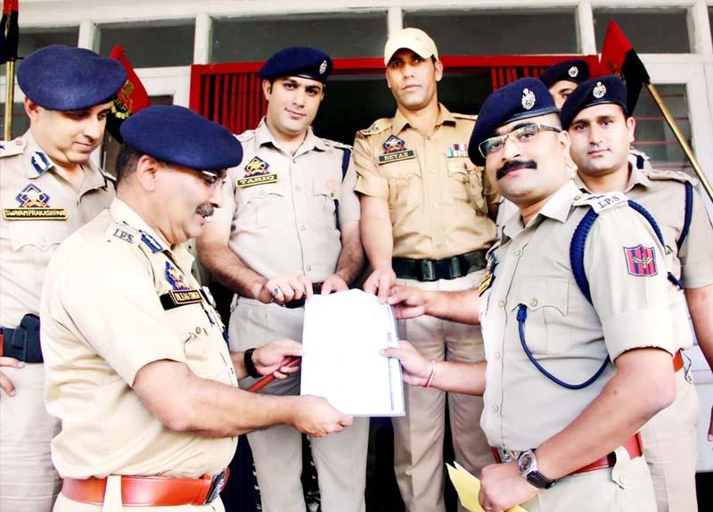 DGP Dilbagh Singh felicitating an officer during visit to North Kashmir.