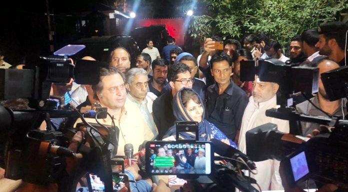 Mehbooba Mufti-led political delegation addressing media outside Raj Bhavan after meeting with Governor.