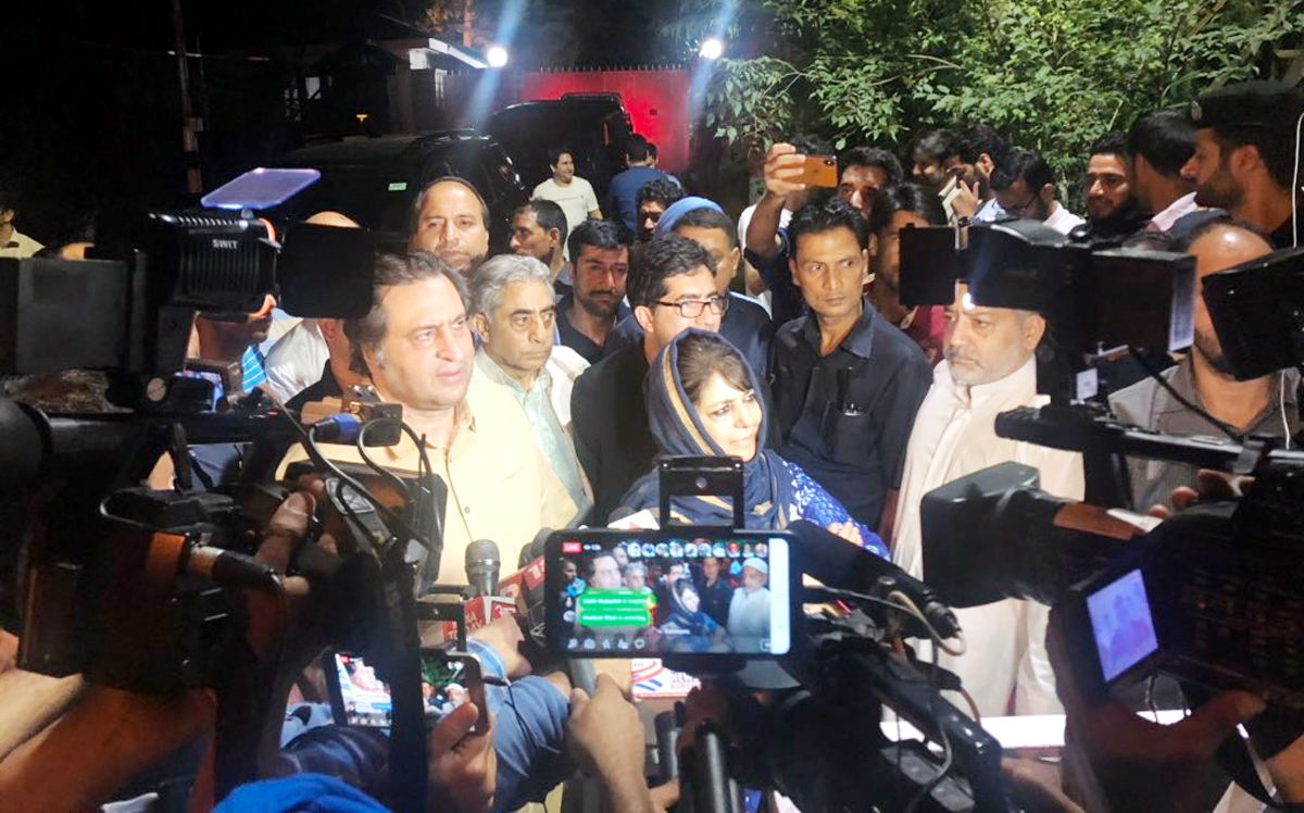 Mehbooba Mufti-led political delegation addressing media outside Raj Bhavan after meeting with Governor.