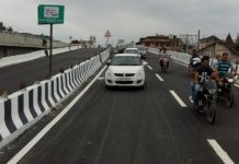 Traffic moving on Jehangir Chowk flyover in Srinagar on Saturday.