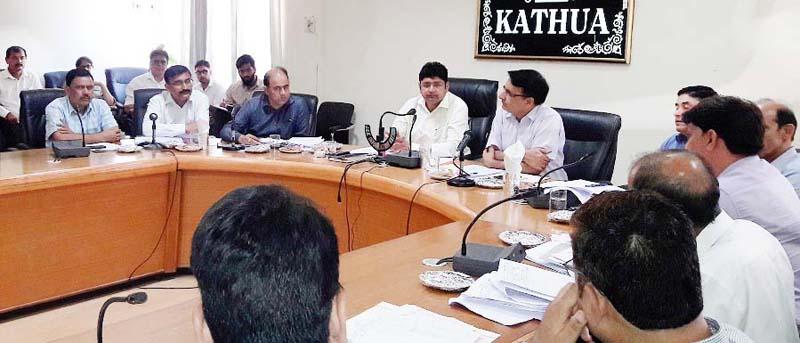 DC Dr Raghav Langer chairing a meeting at Kathua on Monday.