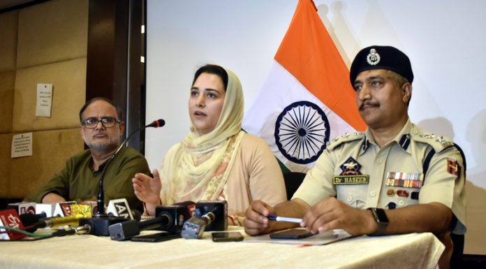 Government officials addressing a press conference in Srinagar on Tuesday.