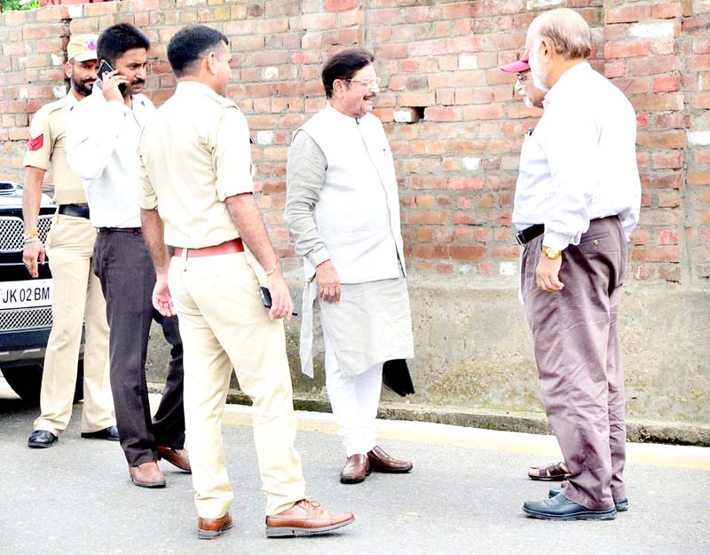 DSS president GS Charak being detained by Police before press conference in Jammu on Tuesday. -Excelsior/Rakesh