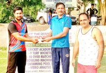 Rohan Koul being presented man of the match award at KC Sports Club in Jammu.