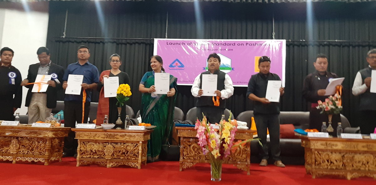 Chairman/CEC, LAHDC, Gyal P Wangyal and dignitaries releasing Indian Standard on Identification, labeling and marking of Pashmina in Leh on Friday.
