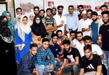 Aryans J&K students posing after being honoured by DC Srinagar.