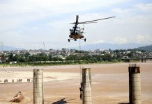 Indian Air Force helicopter rescuing labourers trapped in flooded Tawi near 4th bridge on Monday. -Excelsior/Rakesh