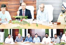 Advisors K K Sharma and K Skandan chairing a meeting at Kishtwar.