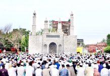 Members of Muslim community offering Eid prayers at Eidgah, Jammu on Monday. -Excelsior/Rakesh