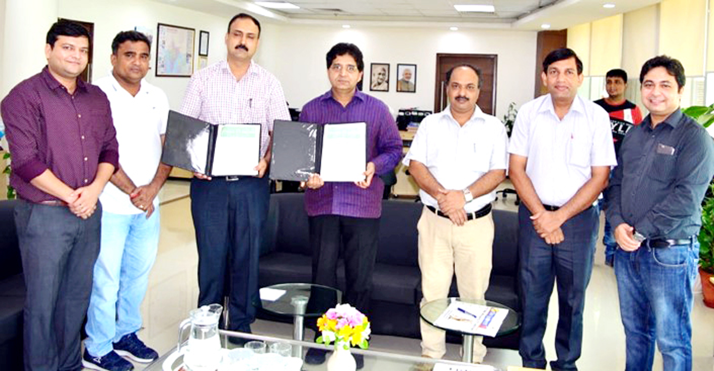 Representatives of SMVDU and NISE displaying copies of MoU signed between the two institutions.