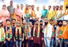 Members of Gorkha community & activists of Congress Sewa Dal posing for a photograph with BJP leaders after joining the party in Jammu on Monday.