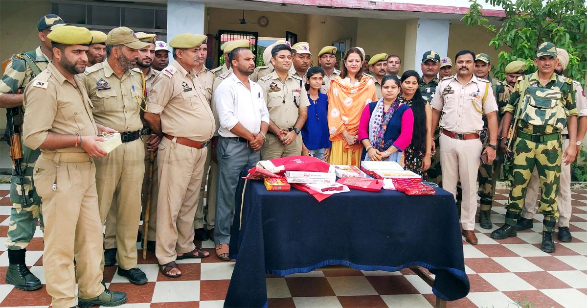 Members of Women Club at R S Pura Police Station for celebrating Rakshabandhan with Policemen & CRPF jawans on Monday.
