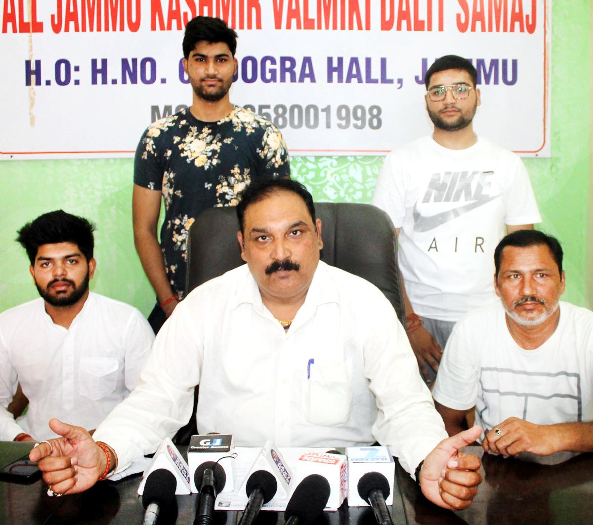 Leader of J&K Valmiki Samaj, Dev Anand Gill addressing a press conference at Jammu on Monday. -Excelsior/Rakesh