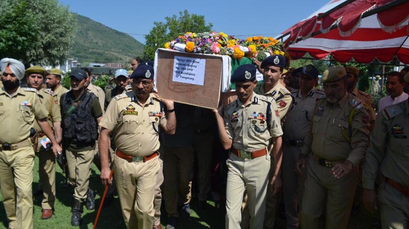 DGP Dilbag Singh and others taking mortal remains of martyred SPO Bilal Ahmad Magray for wreath laying ceremony at Baramulla.