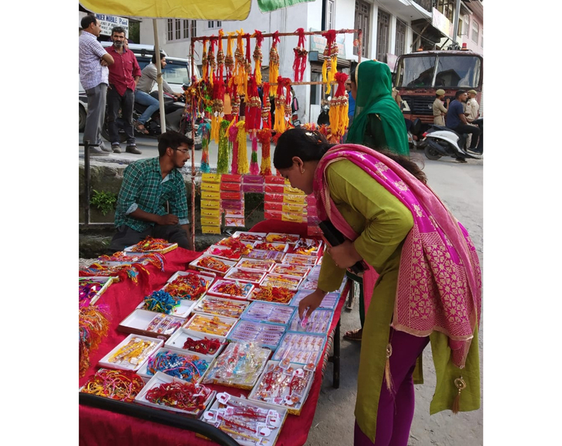 A woman selects 'Rakhis' as markets re-open in Bhaderwah on Sunday. —Excelsior/Tilak Raj