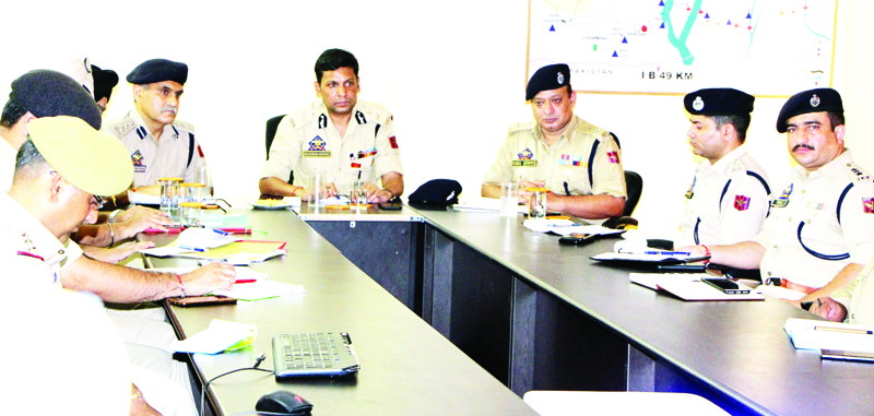 IGP Jammu Zone Mukesh Singh chairing a meeting at Samba on Saturday.
