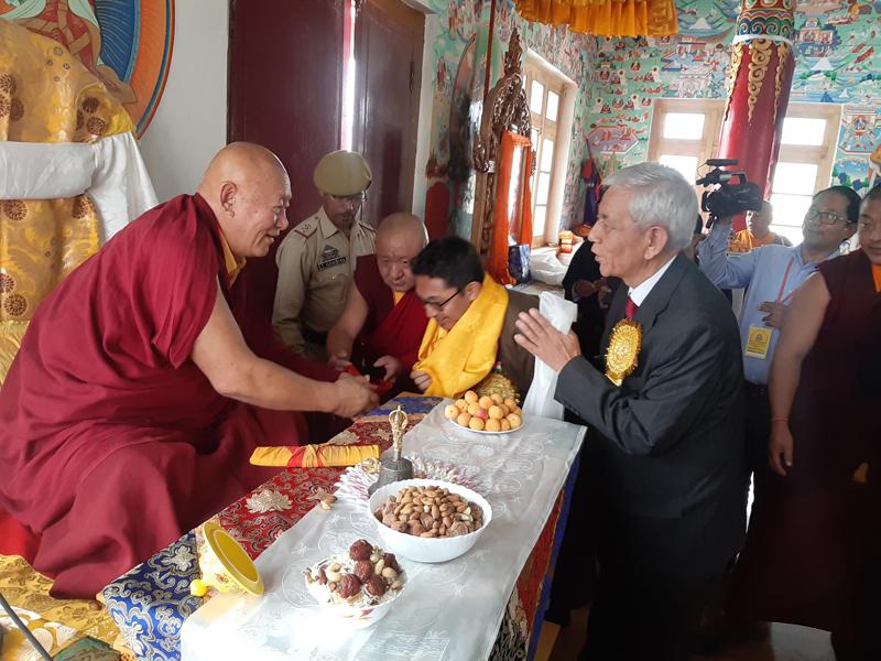 Ladakh MP and others paying respect to Drikung Kyabgon Chetsang during a seminar at Leh on Saturday.