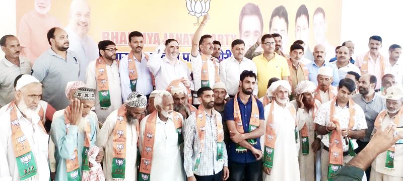 MLC, Vibodh Gupta posing with Muslim leaders who joined BJP at Rajouri on Saturday.