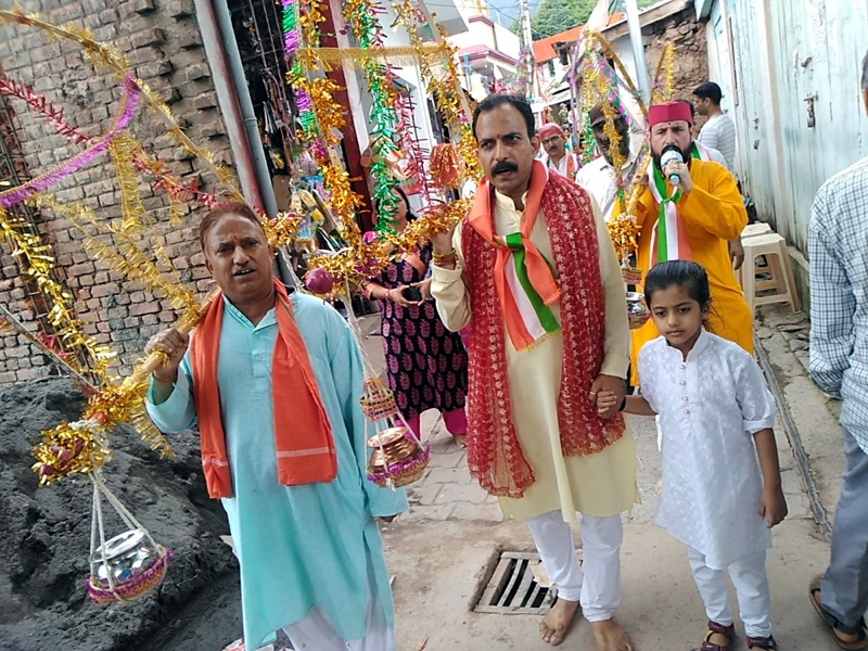 Kavad Yatra being taken out at Sudhmahadev on Wednesday.