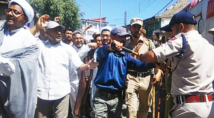 Cops try to stop protesters in Kargil on Thursday. -Excelsior/Basharat Ladakhi