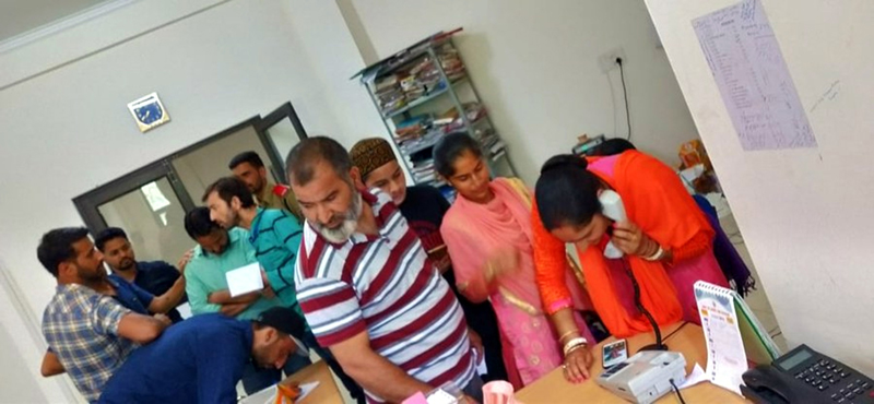 People using helpline numbers in the office of DC Kishtwar on Tuesday.