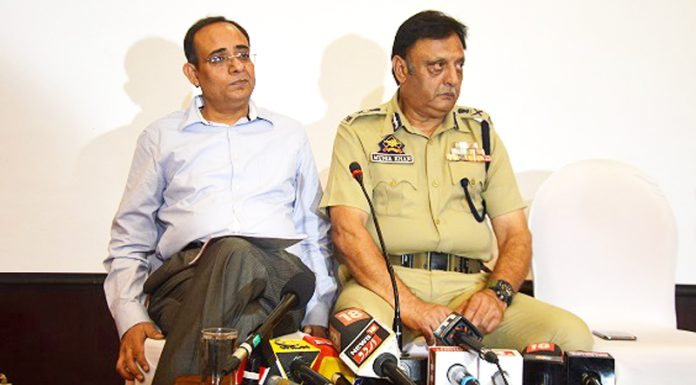 Principal Secretary Planning Rohit Kansal and ADGP (Law & Order) Muneer Khan addressing a press conference in Srinagar on Wednesday.