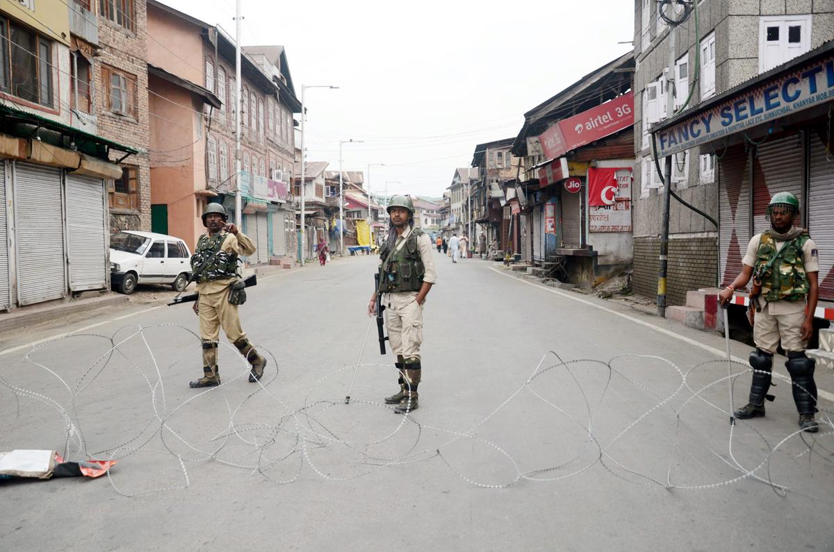 Para-military personnel maintain vigil at a Srinagar road on Friday. -Excelsior/Shakeel