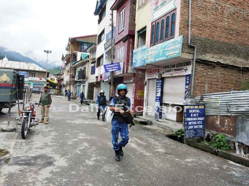 Troops patrol a deserted road in Bhaderwah on Friday.-Excelsior/Tilak Raj