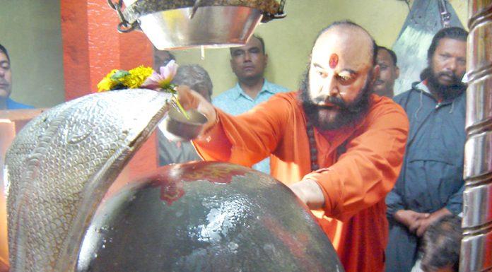 Mahant Deependra Giri Ji and other Sadhus performing religious rituals at Shankaracharya Temple, Srinagar where holy Mace was carried on Thursday.
