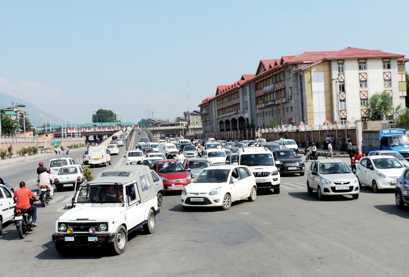 A good number of private vehicles were plying on Maulana Azad Road in Srinagar on Monday. (UNI)