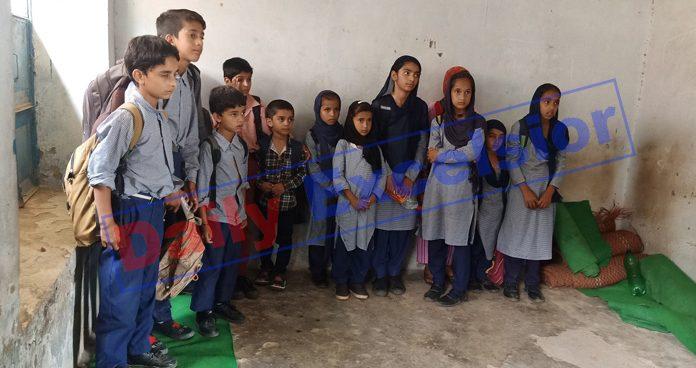 Students trapped in Govt Mobile School at Darana, Mendhar on Thursday. —Rahi Kapoor