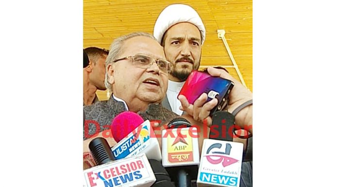 Governor Satya Pal Malik speaking to media persons in Kargil on Friday. JAC Kargil chairman Sheikh Nazir is also seen. -Excelsior/Basharat Ladakhi