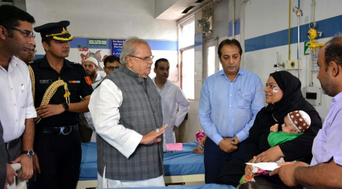 Governor Satya Pal Malik inquiring condition of a patient at GB Pant Children Hospital in Srinagar on Friday.