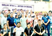 Young shooters posing for a group photograph after excelling in 23rd Delhi State Inter-School Shooting Championship.