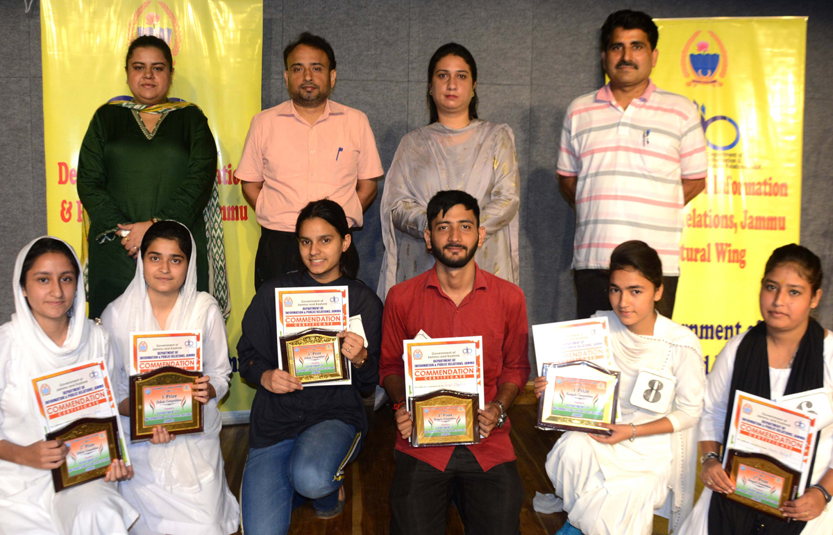 Winners of Inter-Collegiate Rangoli, Debate competition posing for a group photograph in Jammu.