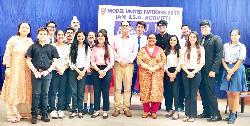 Delegates of Mock UN on Sustainable Development posing for a photograph at Heritage School in Jammu.