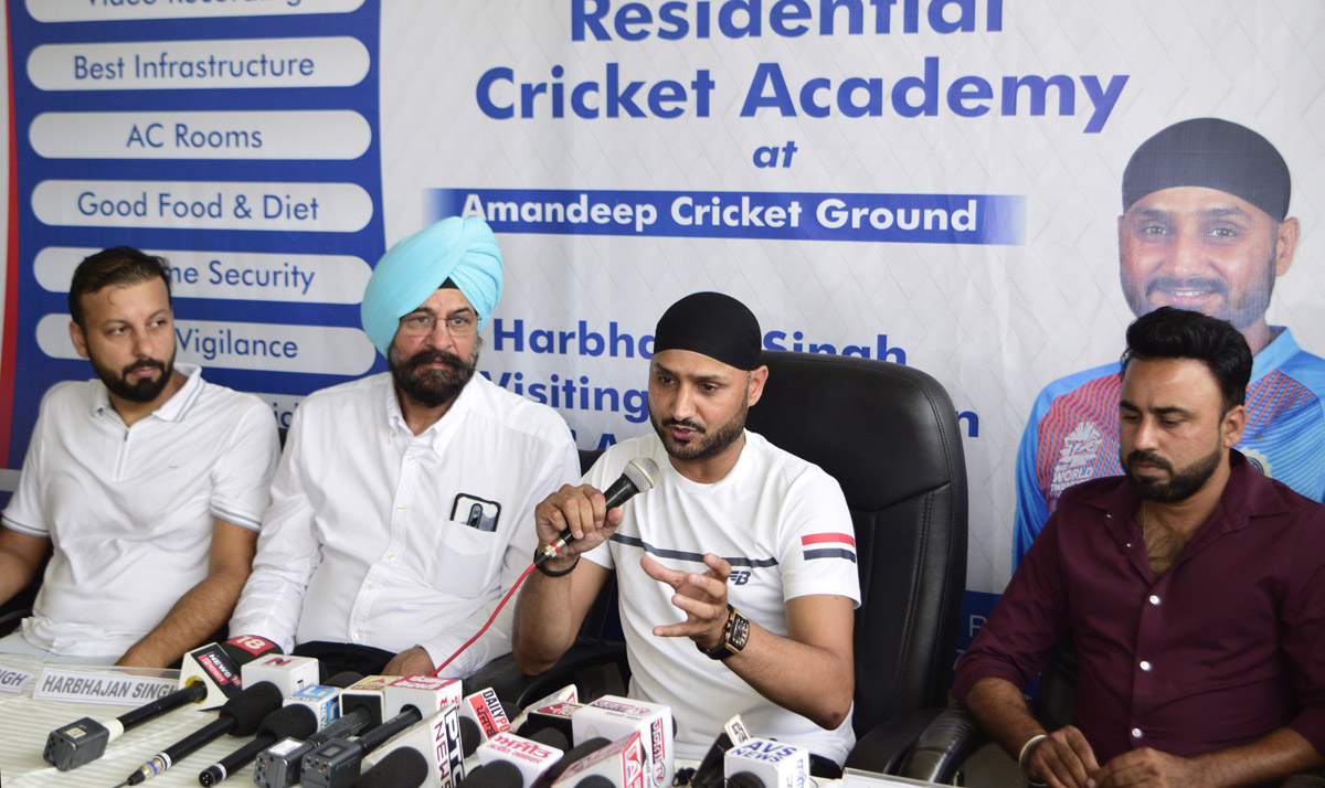 Former Test cricketer Harbhajan along with organisers addressing media persons at Amandeep CA, Amritsar in Punjab.