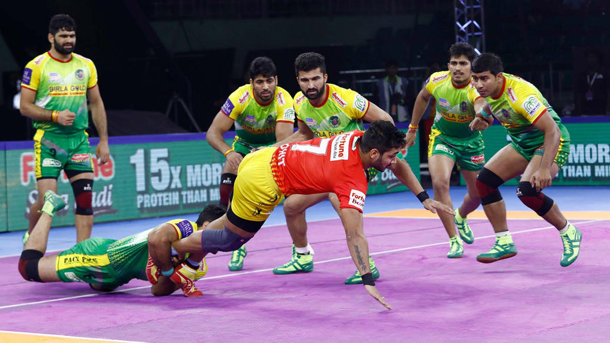 Players in action during Pro Kabaddi League match between Gujarat Fortunegiants and Patna Pirates in Chennai.