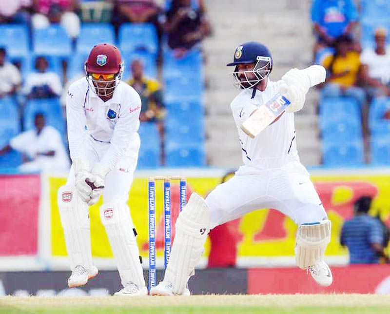 Rahane executing a shot during his knock of 102 runs against West Indies.