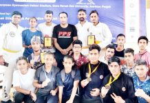 Medal winners of Pencak Silat Championship posing for a group photograph.
