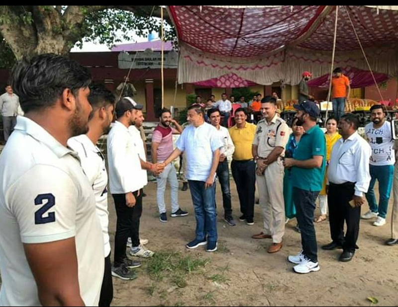 Former Minister Sham Lal Sharma interacting with players during concluding ceremony of Akhnoor Champions Cricket Tournament-2019.