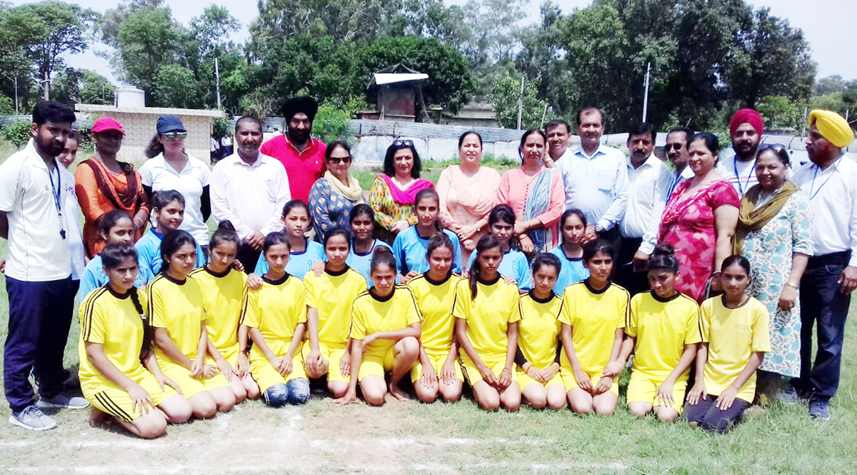 Players posing for a group photograph along with DYSSO Jammu, Chanchal Kour during opening ceremony of Inter Zonal competitions in Jammu.
