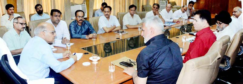 Advisor K K Sharma chairing a meeting at Jammu on Tuesday.