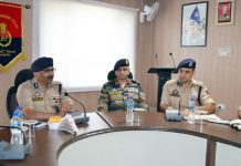 DGP Dilbag Singh chairing a security review meeting at Rajouri on Sunday.