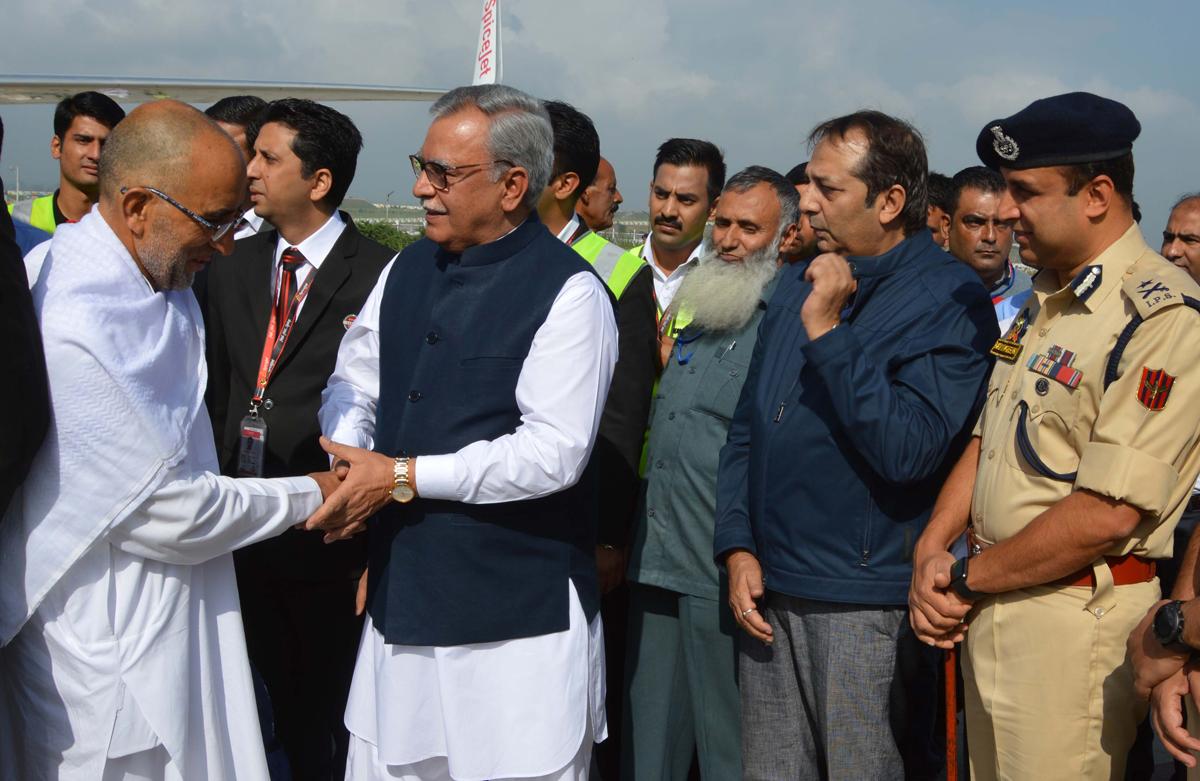 Advisor Farooq Khan receiving Hajis at Srinagar airport on Sunday.