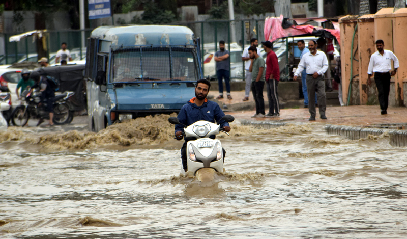 Waterlogged Lal Chowk on Thursday. — Excelsior/Shakeel