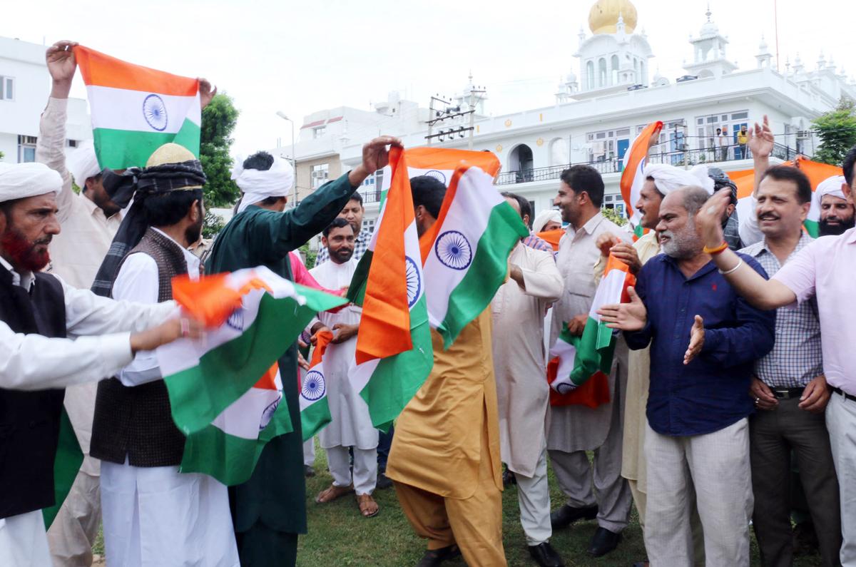 Members of Gujjar community celebrating abrogation of Article 370 at BJP office Trikuta Nagar on Saturday. -Excelsior/Rakesh